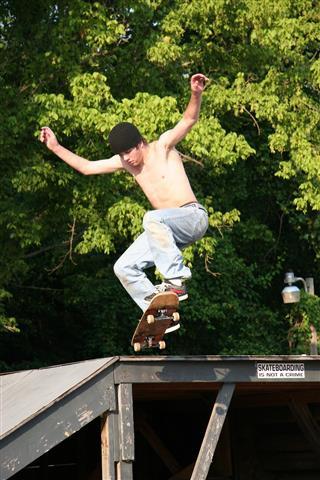 Skateboarder Going off Platform