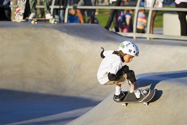 Girl Performing at Skateboard Park