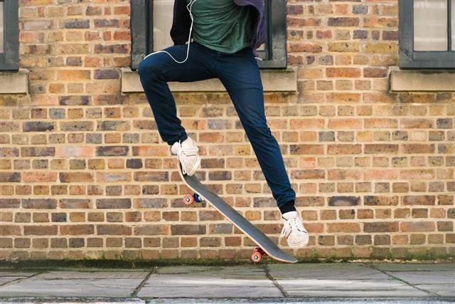 Skateboarding man