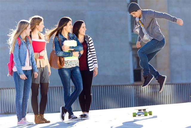 teenager skate on the street