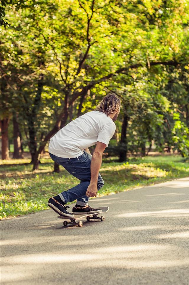Skateboarder riding on slope