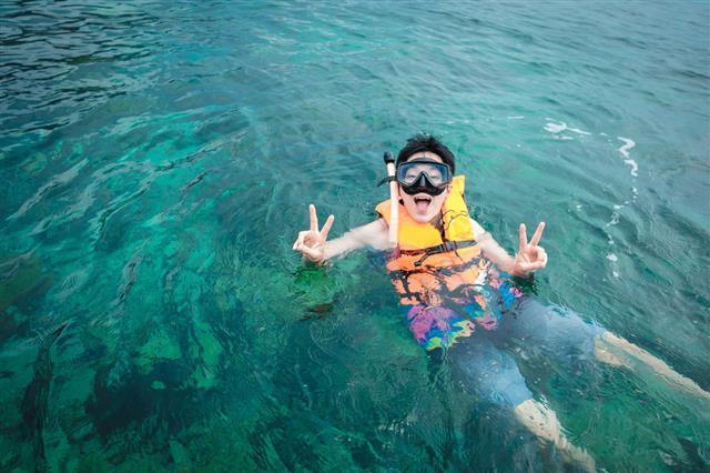 Man Snorkeling In Blue Sea