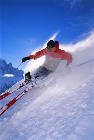 Man Skiing Down Steep Slope