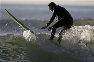 Senior Surfer Exits A Wave