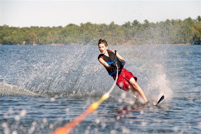 Teenage Boy Water Skiing On A Lake