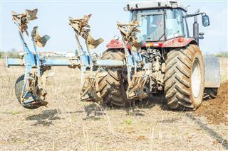 Tractor Plowing In Field
