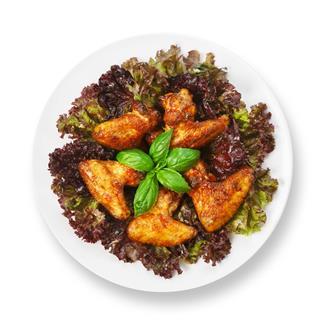 Fried Roasted Chicken Wings On Lettuce