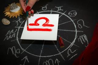 Female Astrologer Draws Libra Zodiac Sign