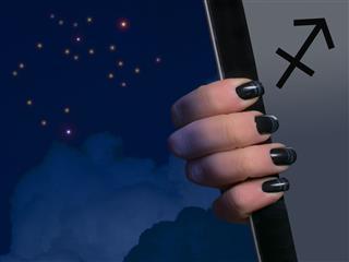 Sagittarius Has A Black Manicure