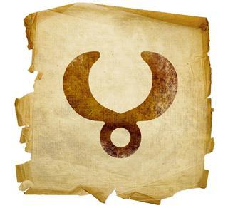 Taurus zodiac symbol on paper