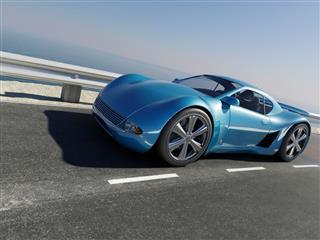 Sports Car On Coastal Road