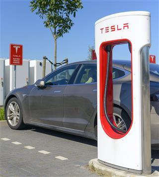 Tesla Model S Car At Charging Station