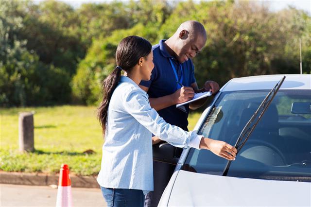 Driver Checking Windscreen Wiper