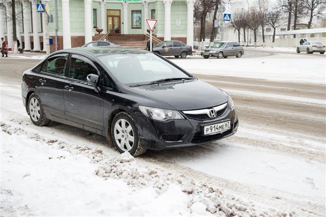 Honda Civic Hybrid On Snowy Street