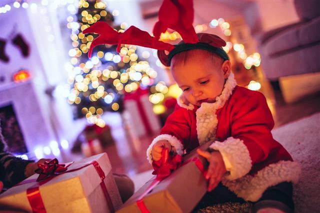 Baby opening gift