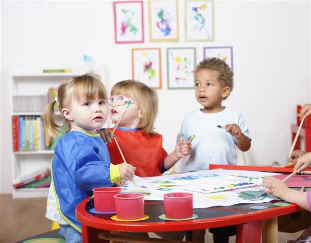 Preschooler Painting In A Nursery Setting