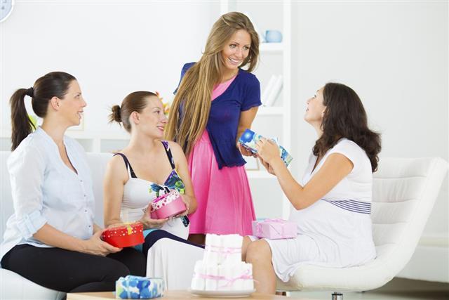 Cheerful Pregnant Women Having Baby Shower