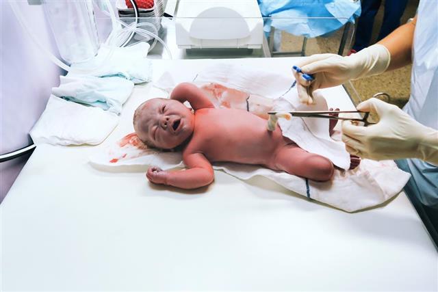 Newborn in nursery after childbirth