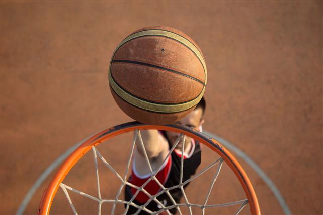 Basketball Player Making Slam Dunk
