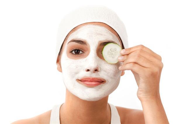 Woman Applying A Facial Mask
