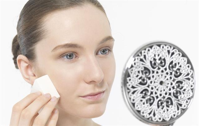 Woman Removing Makeup