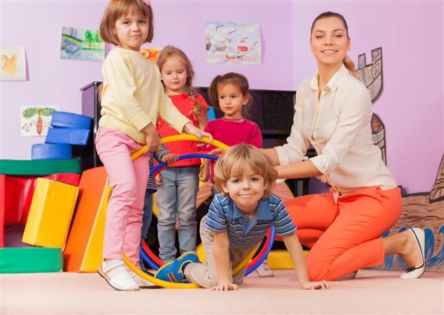 Teacher, kids in kindergarten
