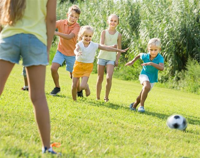 Kids kicking football