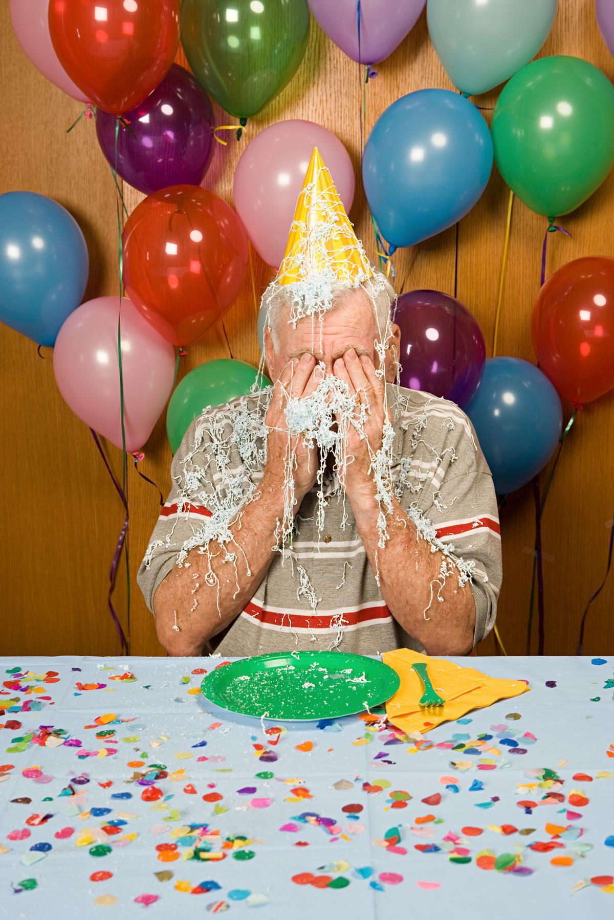 Senior Man At A Party