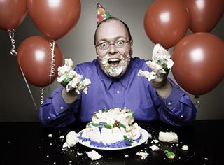 Man Eating Birthday Cake