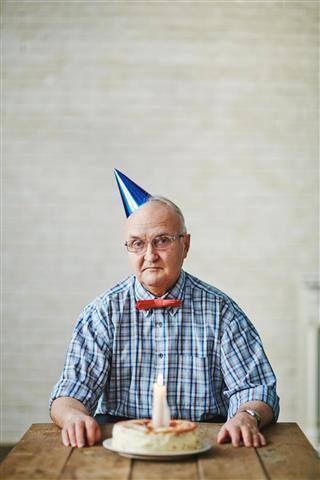 Senior man at birthday party