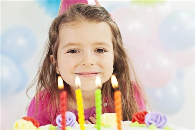 Birthday girl making a birthday wish