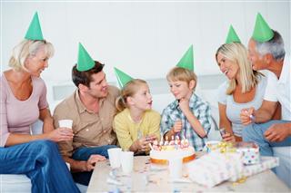Multi generational family celebrating kid's birthday together