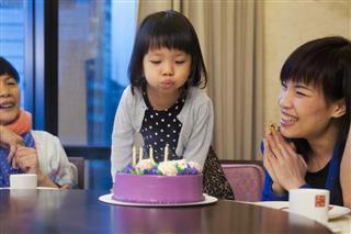 Asian family celebrating a birthday