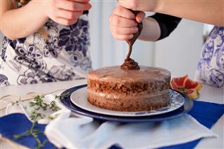 Two Girls Making Cake