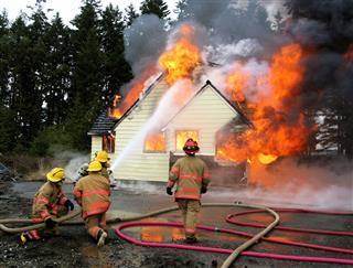 Firemen Fighting Residence House Fire