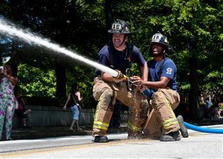 Firemen Aiming At Target