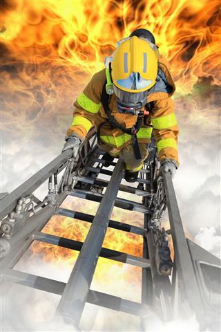 Firefighter Ascending On Ladder