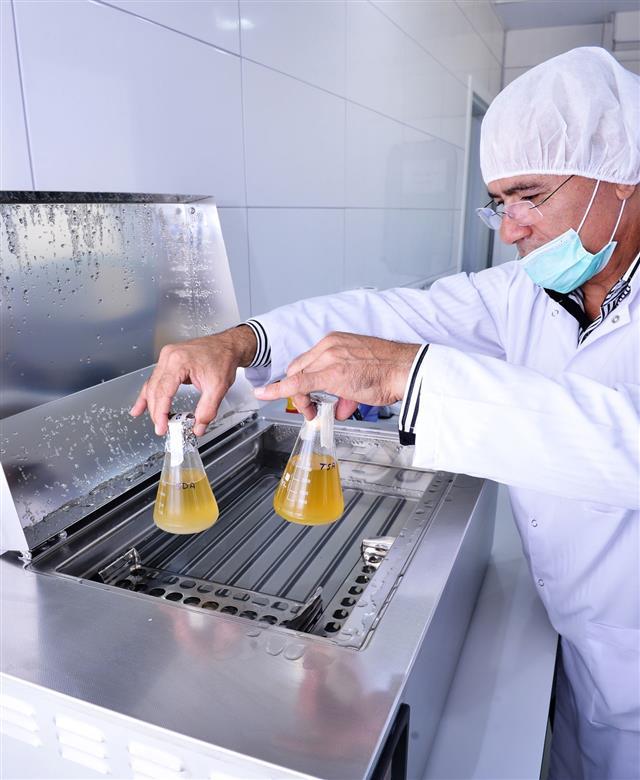 Technician Putting Flasks