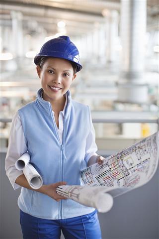 Smiling Architect With Blueprints