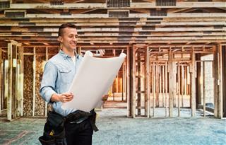 Smiling Male Architect Holding Blueprint
