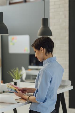 Interior Designer Working In Her Office