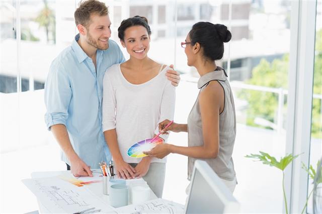 Interior Designer Showing Color Wheel