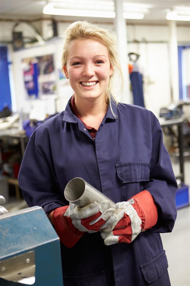 Engineer Working On A Factory Floor