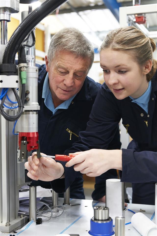 Engineer Working On Machinery
