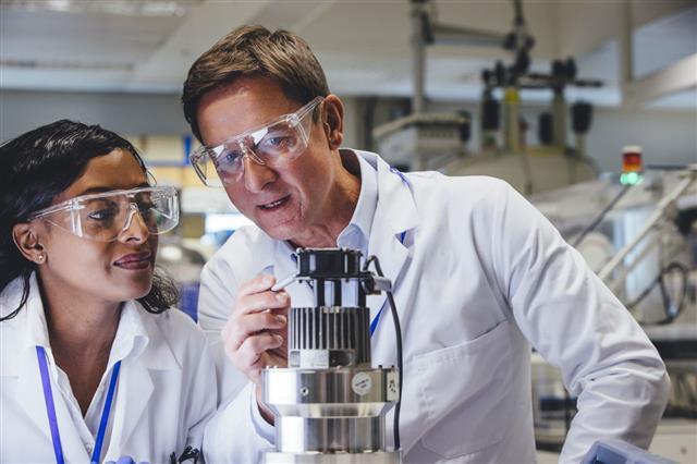 Medical Engineers Examining Equipment
