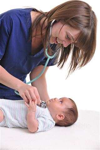 Nurse Checking A Baby