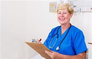 Senior Nurse In Hospital Ward