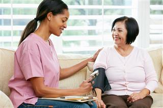 Nurse Home Visit To Senior Patient