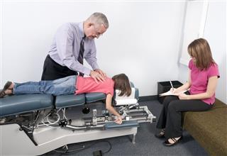 Chiropractic Doctor Adjusts Elementary Girl