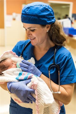 Nurse Feeding A Newborn